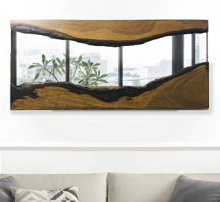 At The Druid's Garden, we pride ourselves for unique designs that seamlessly fit into your home whilst maintaining integrity. . Our live edge wood art mirror, helps you tie your room together by pulling focus and providing character