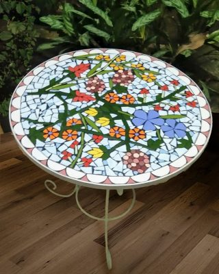 Perfectly encapsulating the love for nature and patterns is our white mosaic table, an elegant companion for both your garden landscape as well as your front porch or balcony!